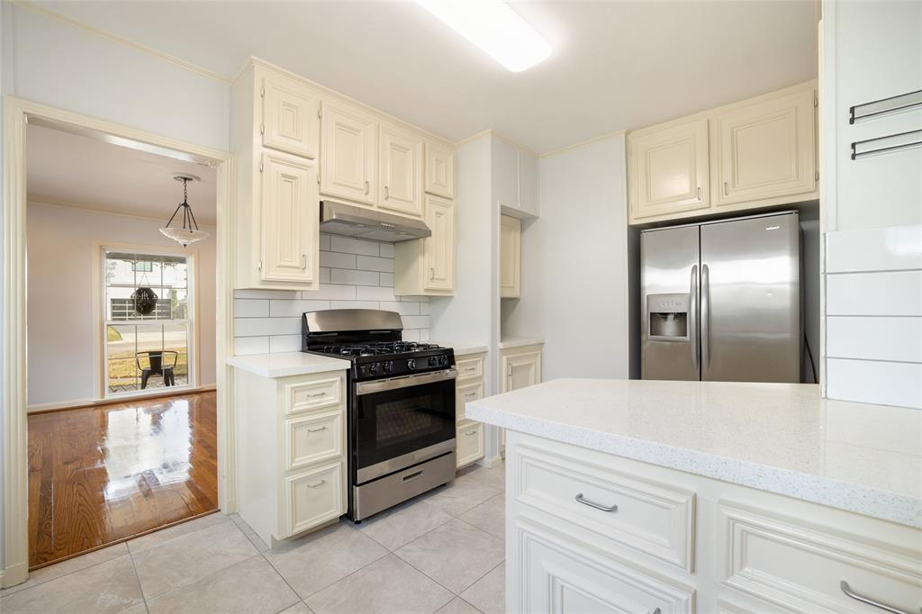 The family chef will love the brand new gas range and vent hood. The kitchen features tons of storage options.