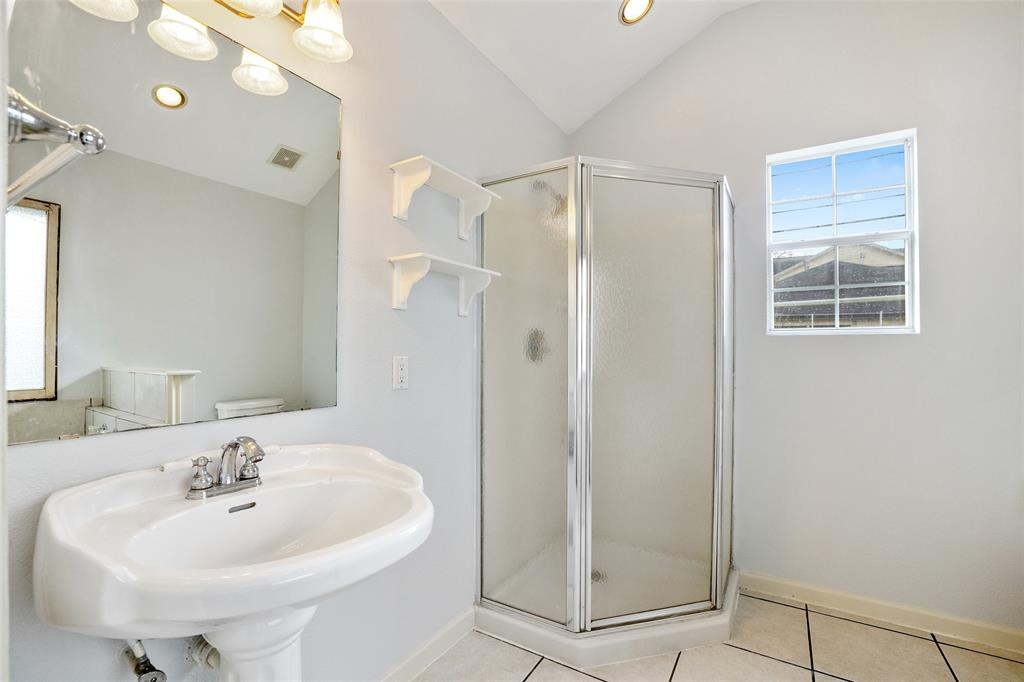 The spacious primary bath features a separate tub and shower.