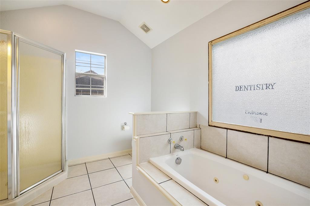 The primary bath also features a jetted tub.