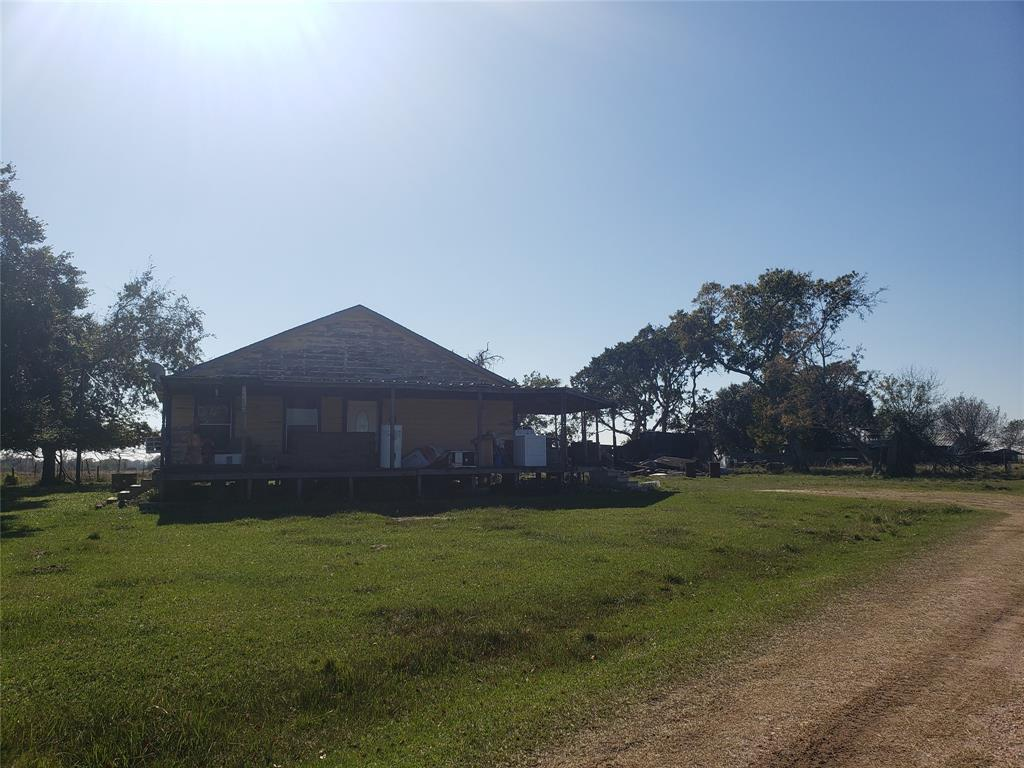 12 acre gated lot in the heart of Needville with plenty of options. Walking distance to Needville schools, a minute from Hwy 36, very quiet area and yet reasonable distance to Highway 59. Property has a home in need of TLC but is priced at lot value only.