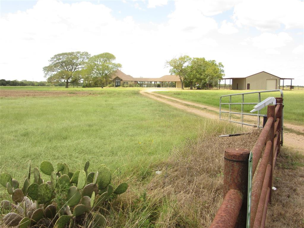 """Connor Ranch is unique property for cattle operation with large pastures, cross fenced with new fences on perimeter and interior. Large metal building 175X100 with 7 rollup doors, working cattle pens under roof, tool room, restroom, shop/break room. Two(2) working windmills feeding concrete troughs and cistern at metal building. Has four(4) pavilions for storing equipment and hay. One solar powered w/w, three (3) irrigation wells, 1000 ft, 400 ft, 350 ft.  The 1000 foot well since 1954 being reworked, 20"""" casing for 400 feet and then 12"""" casing.  The other well has a 12"""" casing and then 6"""" casing and pumps 500 gallons per minute, other well is 8"""" casing and works. Metal building is 5 years old and cost about $500,000 to construct. Has one producing oil well near the south fence line. Conveying 20% minerals what he owns. Has about 175 acres of wooded live oaks, other hardwoods for hunting and a two(2) acre pond on the back side. One deer stand,plenty of deer, hogs and other wildlife."""