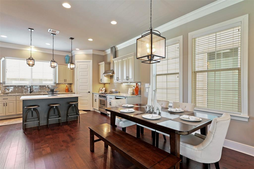 The dining space adjacent to the kitchen is large enough to fit a six or eight person dining table