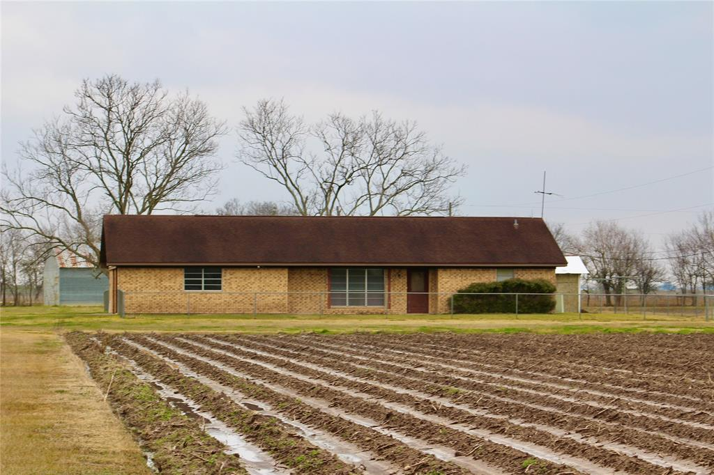 Welcome to 12528 Koym Rd! This farm, featuring a one acre homesite in the middle of 98 acre of lush farm land has road frontage on Behrens and Koym Rd!  The brick home is almost 1700 square feet, is wide open and the renovation possibilities are endless! The farm has 6 barns/buildings and are big enough for large farm equipment. The property also has a 60 year old commercial well that is used to irrigate the crops year round! A farmers dream!!  The possibilities are endless! Perfect place for a grass farm or cattle land! Seller would be willing to split up the land and sell in smaller parcels. Home and barns to be sold as is. Currently has a farm lease and ag exemption.  Call for details and make your appointment today!