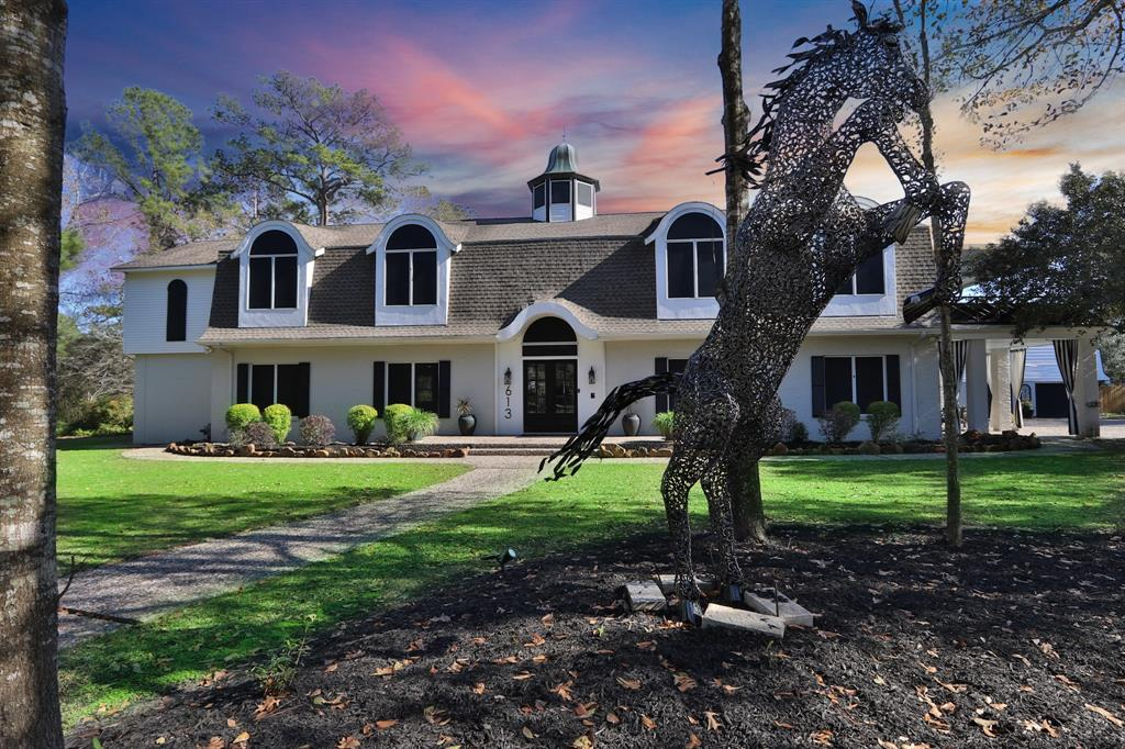 """This exquisite custom home sits on more than 2 acres of picturesque wooded property, Situated in the exclusive gated Community of the """"Lowelands"""" that boasts only 6 homes w/ sprawling oak trees, fenced back yard, pristine pool, and refined living space that includes an elevator with a 4 car garage, pool house w/bar & bathroom & garage apartment! Step into this home to find wood tile floors, custom millwork, LED lighting, walls of windows & impressive upgrades throughout. The kitchen boasts GRANITE counters, designer tile, and high end appliances including a 6-burner cooktop, double convection ovens! The primary suite features a luxurious bath with his/her sinks, spa-worthy tub, exquisite glass-enclosed shower and HUGE closet with an island. Step outside and enjoy your any of your 3 patios, on warm sunny days in your MASSIVE POOL w/16 person hot tub. Conveniently located and close to shops and restaurants or jump on the highway and head to the city or the beach, just a few minutes away."""