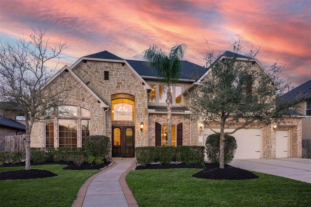 Live the Life of Luxury in this Princeton Classic home located on an oversized 16,470 sf lot in a secluded GATED COMMUNITY. This former model home was built in 2013 with tons of custom upgrades, including SOLID ALDER WOOD CABINETS, double crown molding, and a gorgeous wrought iron staircase. Located just minutes from I-10 in the heart of Katy, you can enjoy a suburban lifestyle with tons of space for the whole family. The huge backyard is a blank canvas to create your own private space, and the extended covered patio is complete with an outdoor kitchen. The OPEN FLOORPLAN is accentuated by HIGH CEILINGS throughout and tons of windows that are all double pane for energy efficiency. The expansive island kitchen is a chef's delight with tons of rich wood cabinetry, high-end STAINLESS STEEL APPLIANCES, and GRANITE COUNTERS. This hard-to-find floorplan features two bedrooms/bathrooms down, including the primary suite, a double staircase with Gameroom, and media room up, and 3-CAR GARAGE.