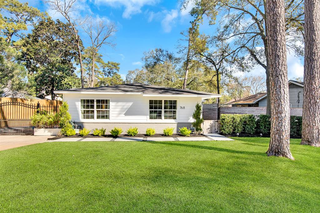 "Stunning updated 1 story home in desirable Garden Oaks. On a large lot surrounded by mature trees across from a small pocket park. Interior features original distressed hardwood floors throughout which gives the home a warm cozy feel. Seller opened kitchen 2019 removed wall between the kitchen and living area for a modern design, installed island with custom ""butcher block"" top with pull out drawers and extra storage, custom oak cabinets, white quartz countertops, farm sink, enclosed laundry area with custom built-ins, surround sound in living, kitchen, dining area. Master updated with Carrera marble countertops, frameless glass shower with rain shower system & handheld showerhead. 2nd bath updated. The large outdoor patio provides great entertainment space with automatic landscaping lights, outdoor speakers, sprinkler system. Double wide driveway with Auto-driveway gate provides extra parking leads to detached 1 car detached garage. 2020 Privacy fence installed."