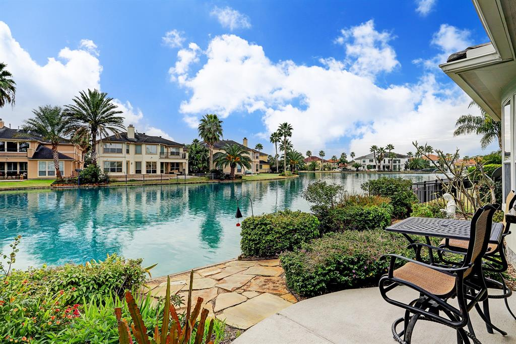 Custom built, lakefront home in the exclusive community of Lakes of Parkway. Leave the stress behind when you enter through the guard gates into this peaceful, private, resort-like community. The guard gate is manned 24/7. Enjoy this rare one-story lakefront home with its abundance of windows, natural light, high ceilings and gracious open floor plan. Main living areas enjoy view of the lake. Then step out onto your covered patio with built-in grill to appreciate the most tranquil, low maintenance lake front back yard. Large island kitchen with amazing counter space any chef would love. Family room is such a warm and inviting room with fireplace and lake views through wall of windows. Awaken each morning to the water view from your spacious primary suite. Study with built-in bookshelves and large closet. Note this home has a three-car garage with extra storage space.