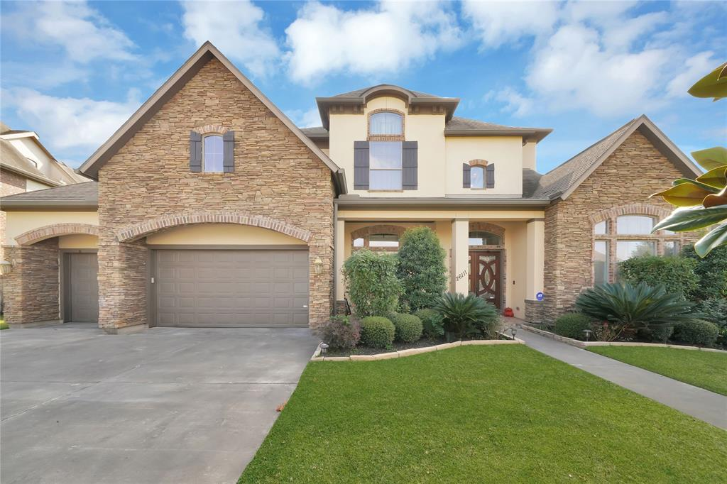 This LUXURIOUS, ALLURING, & MODERN 5-bedroom, 5.5 bath home located in Desirable section of Katy. Amazing floorplan with over lots of upgrades & extras!Dramatic entrance w/high ceilings,   wrought iron staircase,elegant formal dining, study w/custom wood work , HUGE family room with custom beams  &walls of windows- French doors to let in LOTS of natural light & lush greenery which flows into your large island kitchen- customized w/exotic granite tops, natural stone floors,LOTS of custom wood cabinetry  Come home &unwind in your master suite that features a spa-like bath , soaking tub, GRAND shower &custom walk-in closet! Second bedrm down w/ private bath as you can use Guest or Inlaw Suit. Upstairs features w/ large game rm, spacious media rm, 3 oversized bedrms&large closets w/high ceiling.Situated on a quiet street w/covered patio &lush yard and so sparkling pool with lots of amenities.  This premier community has easy access to major highways, nearby fine dining & upscale amenities!