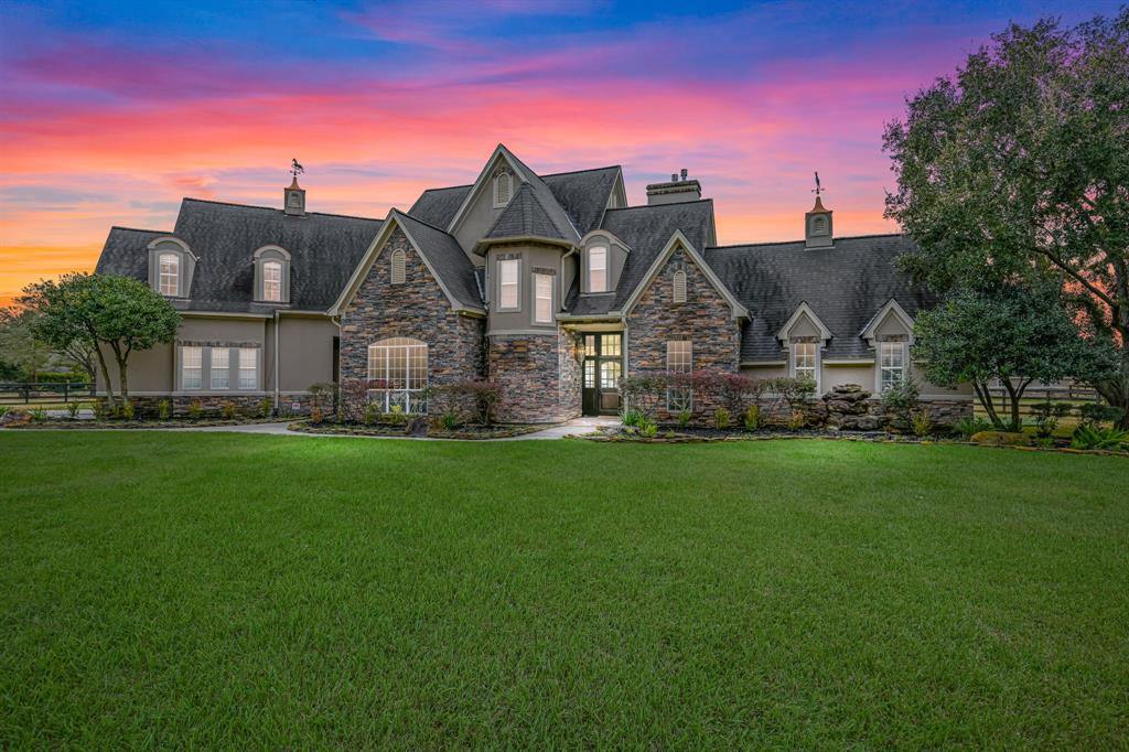 Absolutely STUNNING Custom Home sitting on 5 acres, zoned to CFISD, and within minutes of the Grand Parkway and Hwy 290! Step into this home and you will fall in love! The main house includes an open living area perfect for entertaining, a chef-inspired gourmet kitchen with an extensive island, tons of cabinets, and a new subzero refrigerator. The primary suite is tucked in the back of the house with a fireplace, his and her closets, and a back door that leads to the putting green. The property features a state of the art 4-stall horse barn with a hot-cold wash bay, a lighted riding arena equipped with w/surround sound. The guesthouse includes a full kitchen with stainless appliances, breakfast area, living room, 2 bedrooms, and 2 full baths(all not included in stated sqft). A private pond for fishing makes you feel like your miles away from the hustle and bustle of the city, yet only minutes from all restaurants and shopping.