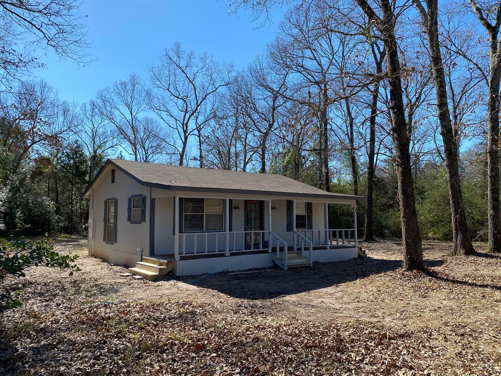 12.99 acres southeast of Centerville.  Picturesque setting with giant trees and scattered openings.  Corner tract with frontage on blacktop road.  850 sq. ft. cabin that was recently renovated.  Two bedrooms and one bathroom with spacious living area.  Two out buildings.