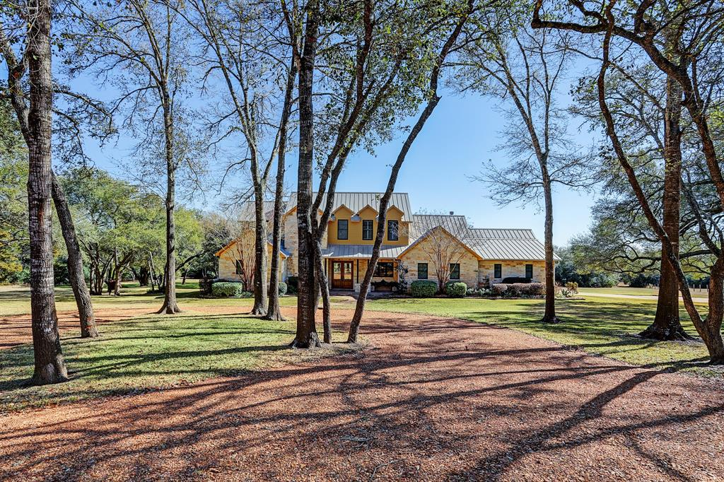 Park View Ranch  Come see over 41 acres of beautiful land filled with trees. This secluded property is conveniently located between Brenham and Round Top.  The custom home is perfect for entertaining with multiple living areas, a great dining area, and a large kitchen with an island as well as masonry. With 4 bedrooms and 4 bathrooms, everyone can have their own space. The home opens up to the gorgeous outside scenery with all of its windows. Walk through the French doors to the generously sized terrace that is fit for a party. The covered patio has a convenient outdoor kitchen for grilling and enjoying your favorite beverages. From the great outdoor areas, gaze at wandering wildlife during the day and stunning stars at night. The property also features a nice barn/workshop.  Come see the views of this property!