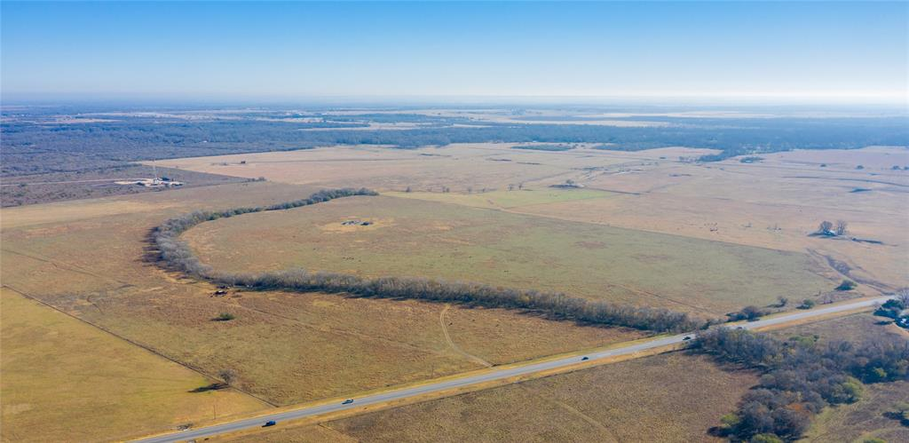 If you are looking for a great cow place, this is it, with some of the best native grass in the county for grazing.  There is fenced hay meadow at the northeast corner to compliment your grazing.  With frontage on Hwy 183 south and two entrances, it has easy access.  Wooden cattle pens are at the highway second entrance.  A seasonal creek and a water well provide water for your livestock.