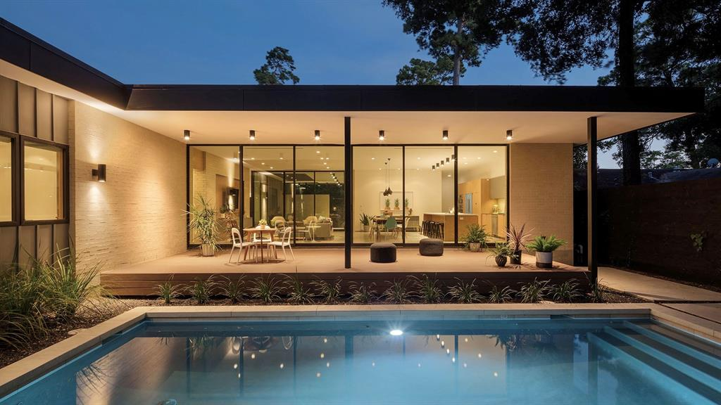 Nestled in the heart of Oak Forest is a jewel box of modern architecture. The brainchild of Shawn Gottschalk and his team at StudioMET, 1914 Ebony Street is the epitome of modern living. Featured on the prestigious AIA Home Tour in 2016, this home was handcrafted from the ground up using only the finest artisans and materials. Every detail has been carefully planned and executed. The front walled courtyard gives full privacy to the main living areas while offering an additional outdoor area separate from the rear yard and pool. The lines between indoor and outdoor space seem to fade with the expansive use of steel and glass that bring the outdoors in. The open layout is perfect whether you're  whipping up a gourmet meal in the well planned kitchen, or hosting a pool party for the neighbors! Beautifully detailed finishes throughout!