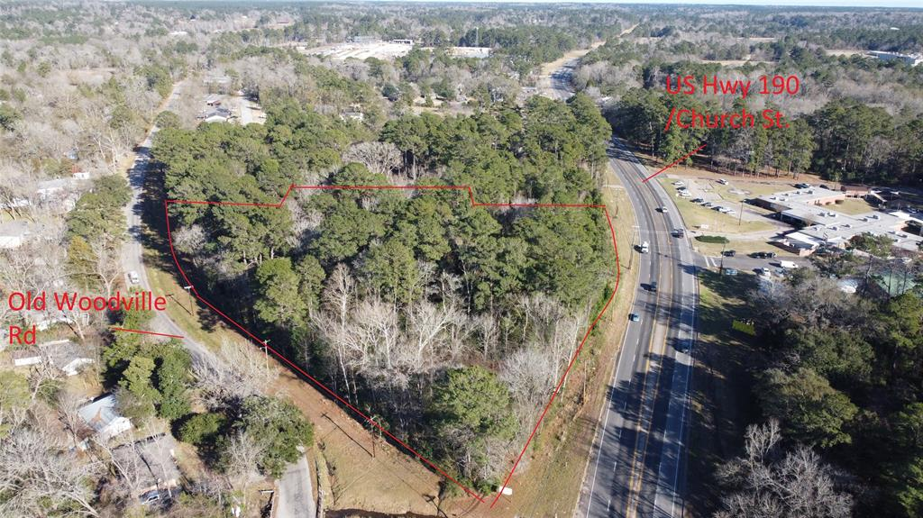 11.5 Wooded Acres at the corner of Hwy 190 and Old Woodville Rd, approximately .15 mile east of the Courthouse on Hwy 190 East.  Good location that can be developed into anything you desire.   About 15 minutes from Naskila Gaming. It could be great location for house, restaurant/motel, convenience store, office, multifamily development. Close to existing development. Owner will consider selling less than full parcel.