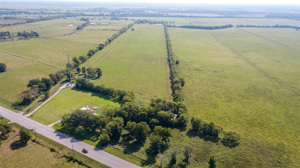 Looking for a Ranch,  look no further.   50.5085 fully fenced acres!  This property includes a hay barn and a 30x50 shop and a water well.   There is a 1 acres pond and 3 smaller ponds.    The property has a dirt pad the seller had ready to build a home on.  Looking for property to subdivide?  It would make a perfect new subdivision.   Use it as a cattle ranch.   There are 3 tax accounts that make up this 50.5085 acres