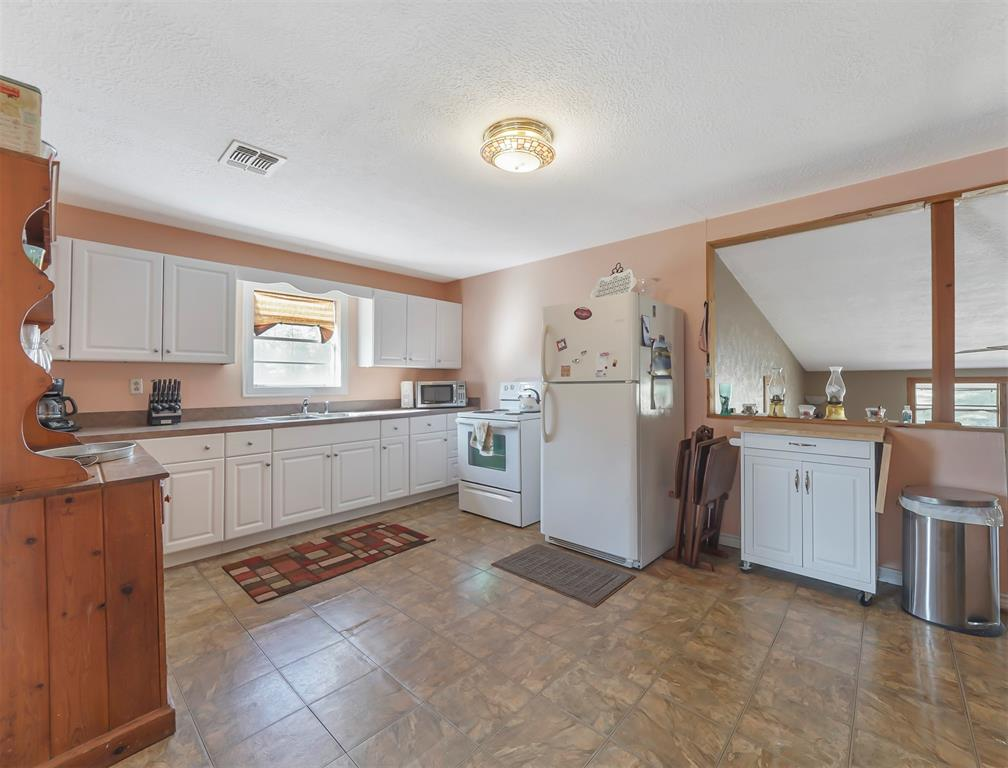 Sizeable kitchen with newer cabinets and plenty of space for storage