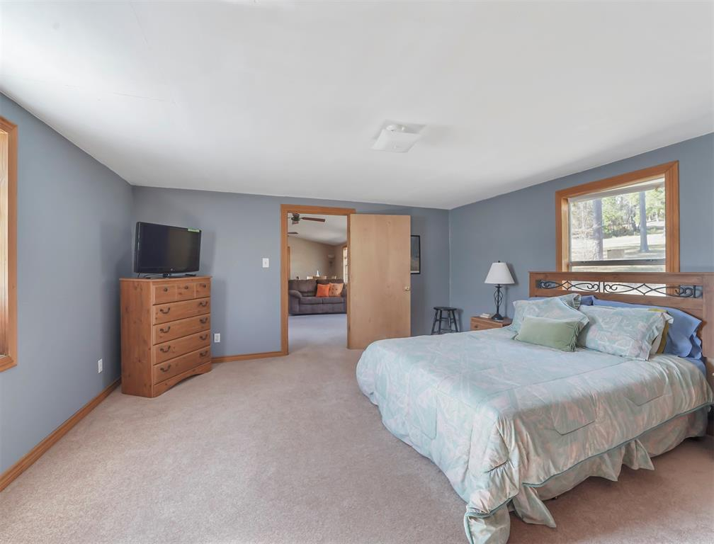 Large primary bedroom en-suite with more views of your wooded land