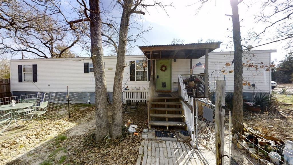 This a rare find! This (2) Lots all in one deal! There is a mobile home and (2) rental income PROPERTY! It comes with a commercial aerobic system! The home and 2 income rentals sit on one lot! The second lot is a blank canvas to make your own. Just in time for Spring! Wooded lot in a quiet neighborhood!