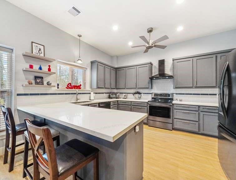A 2-story metal barndominium built in '18, 6,000 sqft building, 1,500 sqft living space, 2 BR, 2.5 BTH upstairs loft. Quiet living with style, the home is bright and open, natural light to fills the home, kitchen is spacious with lots counter space, walk-in pantry, electric appliances, oversized counter peninsula that is also a counter height table. Features a roomy laundry room, lots of storage, home office opens to workshop, master suite with a freestanding soaking tub, walk-in shower, double sink vanity.  Upstairs you will have an additional space for a future loft. Materials included.  The 2-story 75x60 workshop will fit multiple vehicles. Outside has two covered patios, 60x16, big enough to throw a large party and a space for exterior storage, parking and storing equipment. Just 30 miles from Houston There is a deep well, plus an aerobic septic system. 3 phase 240 electric for future power needs.  Property is fenced with 8' fencing & surrounded by forestry