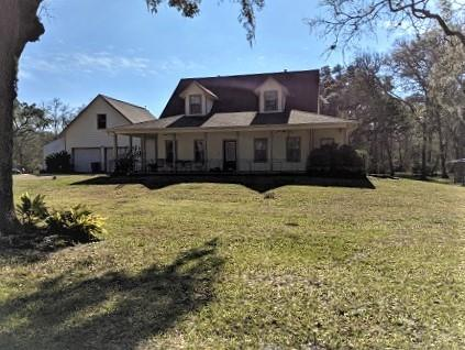 Lovely 1.5 story home in a private country setting on 5.3 wooded acres. Huge barn with workshop and extra storage, chicken coop + horses welcome. Home features many recent updates including: microwave, tile flooring on entire 1st floor, carpet in game room and a whole house generator installed September 2020. Island kitchen with walk-in pantry is open to family room with fireplace. 1st floor master suite includes double sinks, garden tub and separate shower. Game room and secondary bedrooms up. Air Hockey, pool table, dart board and couch in game room are included.