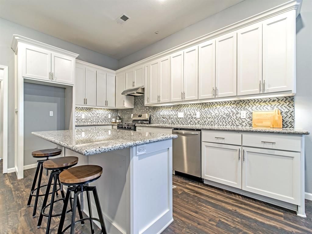 Granite counter tops, plenty of cabinets, gas range, dishwasher, breakfast bar and cabinet space for your refrigerator.