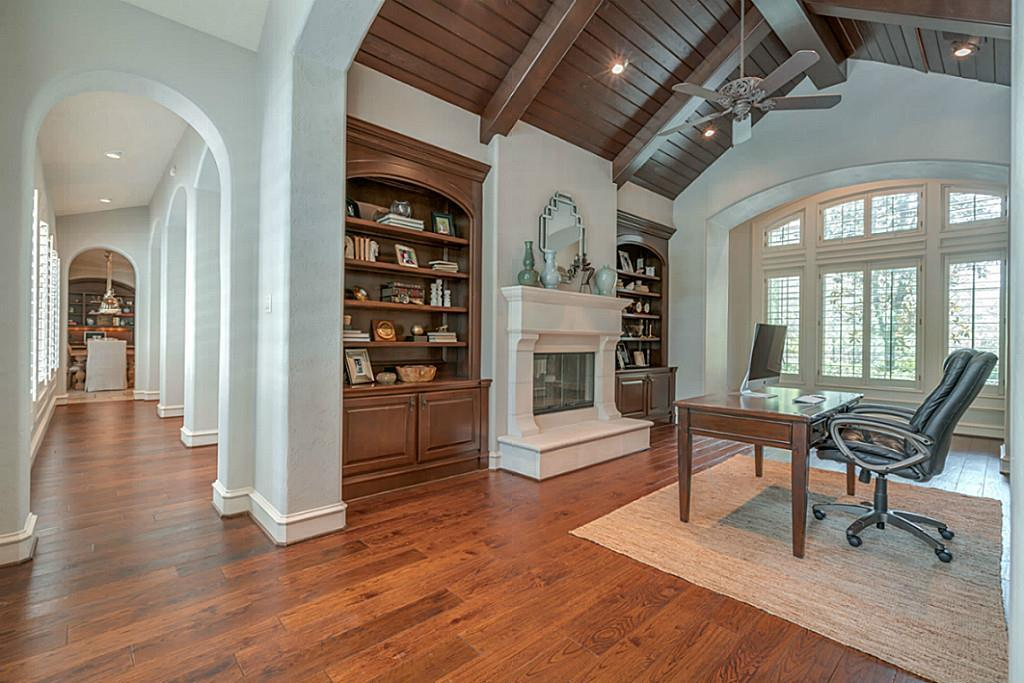 Rare opportunity in The Woodlands - a true 1.5 story w/all bedrooms down! Beautiful hardwood floors, soaring ceilings, & a neutral palette are enjoyed throughout. Stunning office w/vaulted beamed ceiling, fireplace, & generous natural light, an ideal setting for today's work at home needs. With an open concept floor plan, the kitchen/breakfast space is open to the great room &  an eye-catching floor-to-ceiling stone fireplace. Kitchen highlights high-end SS appliances, a large island, & serving counters, both providing additional seating. Around the corner, additional built-in storage with a desk is perfect for students & keeping everyone organized. 2nd floor has a huge flex space with a built-in media center, dual desk/craft area, 2 oversized walk-in closets, & a convenient powder bath.  Walls of windows throughout the home take in views of a private setting complete with pool/spa, outdoor fireplace, & dining area. Pebble sheen pool w/waterfalls & firepots. Putting green!