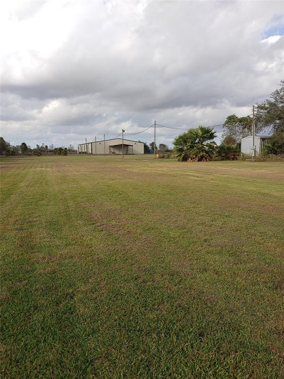 The possibilities are endless!  Take advantage of this rare opportunity to own over 9 acres with FM 1462 frontage including an 8400 Sq ft multi purpose building with AC.   Plenty of room to relocate or start a business and add your dream home still having room for all your toys, tools, and tractors.