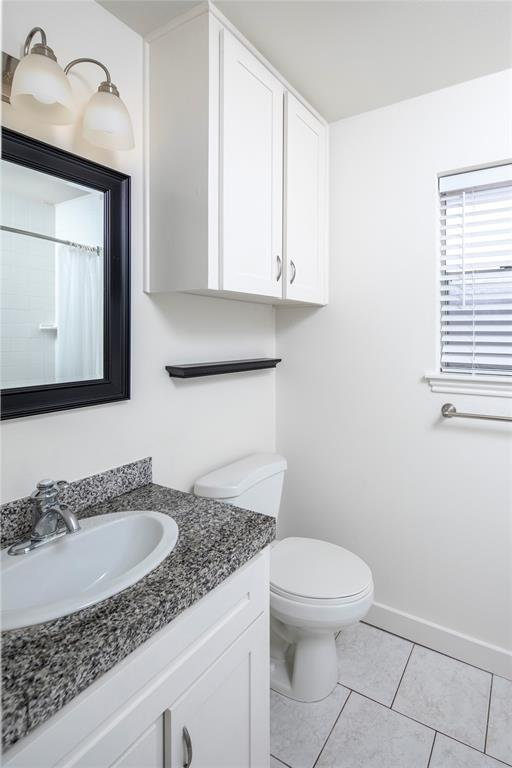 The primary bath includes a subway tiled shower/tub combo (in mirror reflection), and a new light fixture.