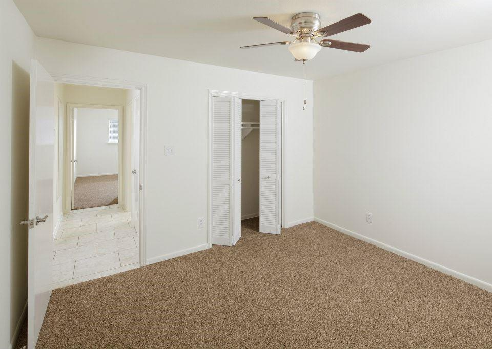 The second and third bedrooms are on the opposite side of the living area from the primary suite. This one sits at the front of the home looking out on Viking Dr.