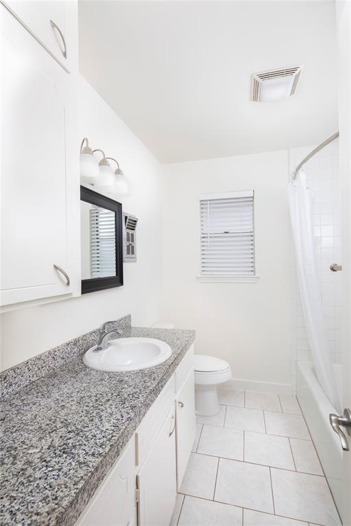 The second/guest bath also includes a shower/tub combo and is located in the hall between the secondary bedrooms.