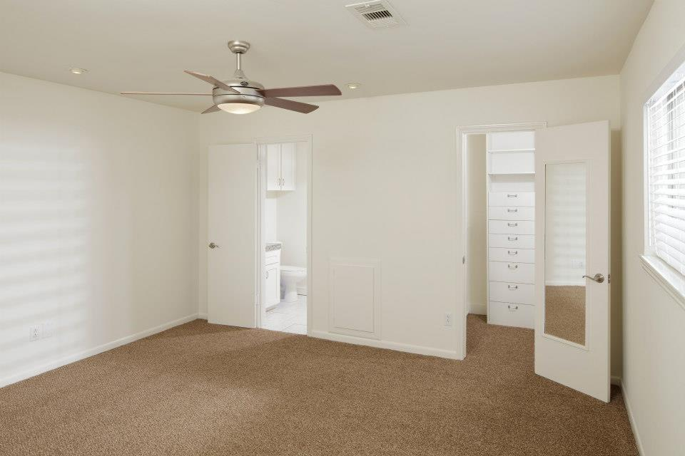 The primary suite sits at the back of the home overlooking the back yard, and has a private full bath, walk-in finished closet and new carpet.