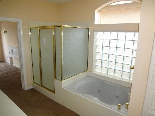 Primary bathroom has separate shower and whirlpool garden tub