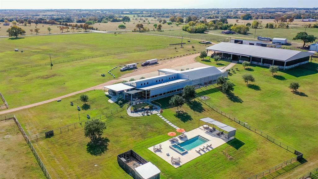 Welcome to Ranchito Martita in Brenham, Texas. This beautiful property is 120.76 acres right on FM 389. Featuring gorgeous antique Live Oaks, Rocky Creek frontage, 3 ponds and 34 +/- acres of hay production. 3 living quarters - Casita- Remodeled 2 bed 1 bath with an enclosed sunroom, 2 porches and a flagstone patio, Owners retreat is 1800 sqft 2 bed 1 bath plus office overlooking the pool and pond with multiple patio areas; Managers apartment 900 sqft with 2 bed 1 bath and patio areas. Custom horse barn with 10 tilt wall & cinderblock horse stalls with metal doors and roll up windows, fly spray system and special lighting, 25000 sqft covered arena 100x200 with holding pens, Procutter flag, sunshades and viewing stands, 5 horse stalls, horse walker; Horse trailer covered parking; Storage barn with 9 bays and 110v & 220v. 10 horse traps ranging from 1/3rd acre to 4 acres with 7 featuring loafing sheds with water. Access is by 2 entrances with auto gates.