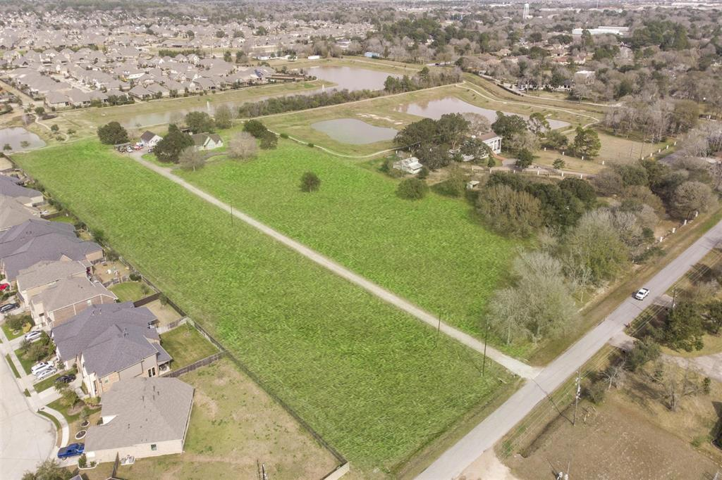 10 wonderful acres in the heart of Katy.  Fabulous opportunity to make this your dream home.  Custom built in 1983 and ready for your personal touches.  Sprawling single story home with built-ins in the Formal Dining area, Study/Library, Living Room and master bathroom.  Detached 40'x30' work shop.  Currently on well and septic  with  city utilities nearby.  Sprinkler system around the home.