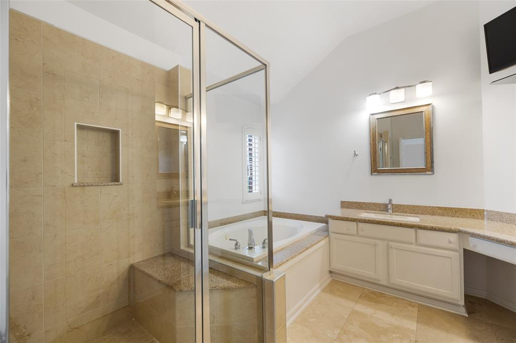 The primary bath features updated tile and granite counter tops.