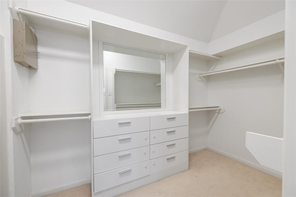 The primary suite features a walk-in closet with built-in storage.