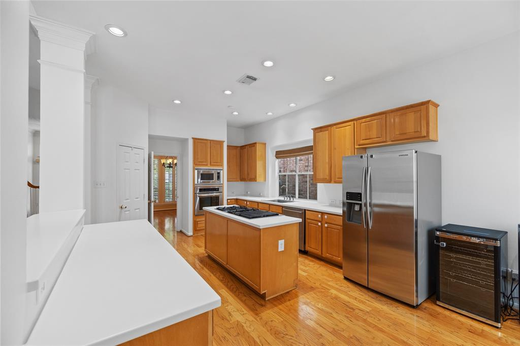 The family chef will love the center island kitchen with stainless steel appliances and gas cook top.