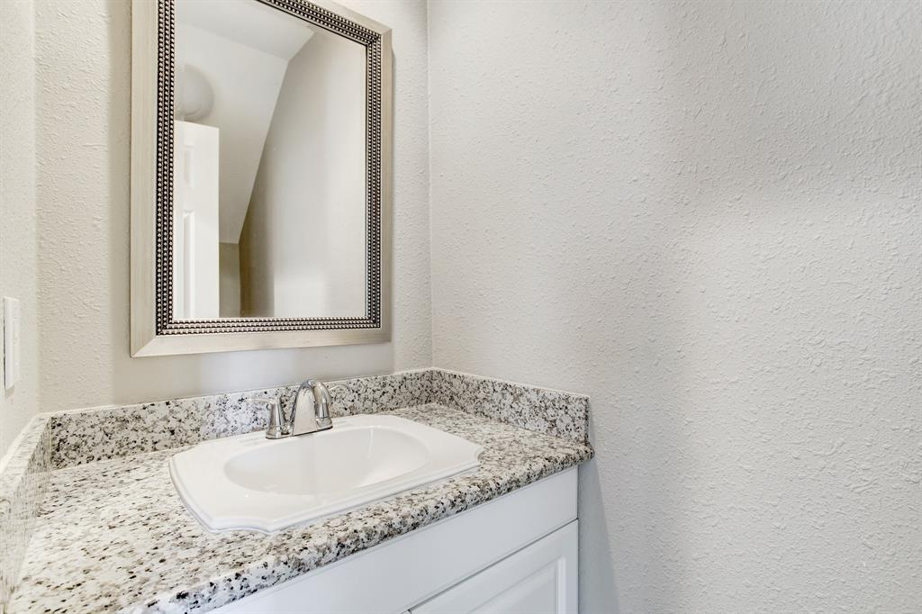 The half bath on the first floor is also finished with granite counter tops.