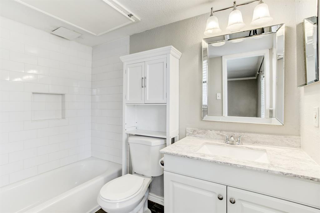 The full bath has also been recently updated including granite and a new vanity and sink, subway tile surround in the shower/tub, faucet and flooring.
