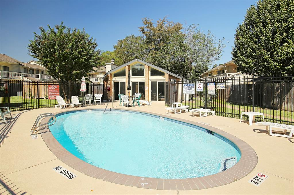 One of the two community pools at Hidden Lake, and the clubhouse which can be rented out by owners for private events.