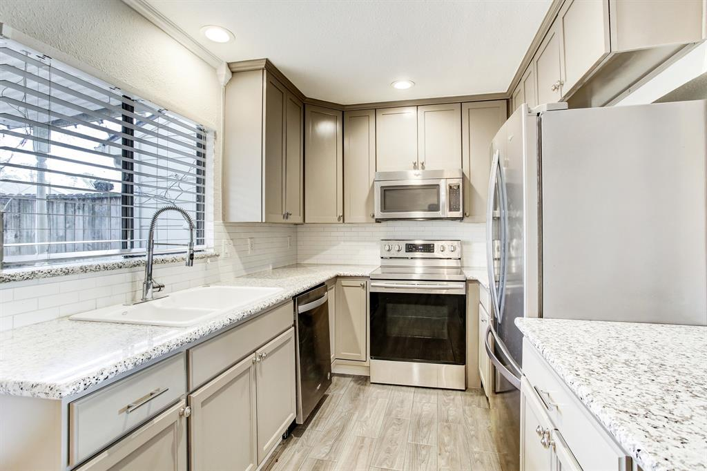 There is wonderful countertop and cabinet space in the recently updated kitchen with granite counters and subway tile backsplash.