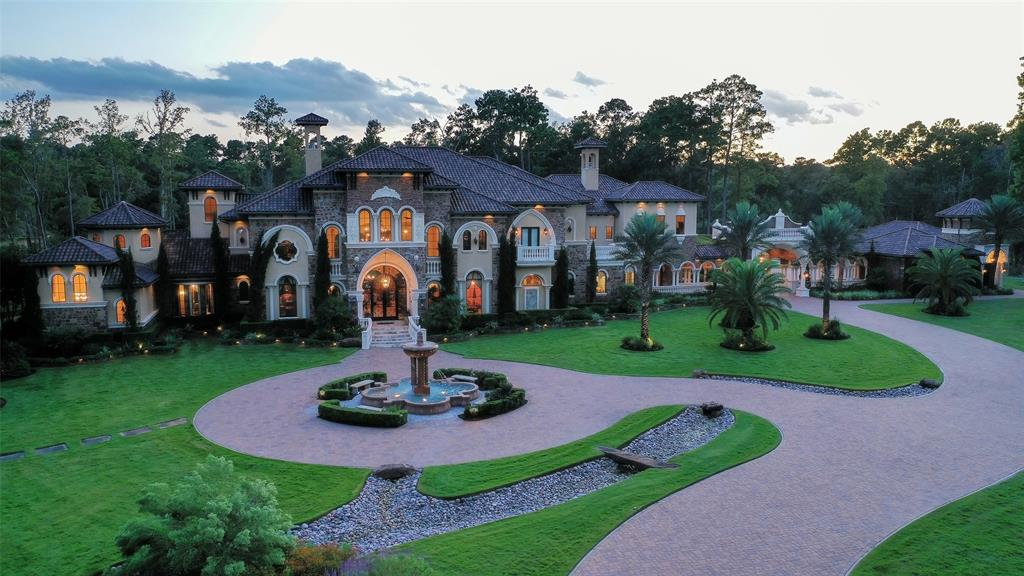 Over 14,000 sq ft of a Luxurious Estate situated on 20.58+/- private acs.Impeccable landscaped grounds behind the gated entrance w/landscaped lighting throughout the entire acreage.Attention to Extravagant Detail in every rm!Stunning groin vault ceiling designs.State of the Art Gourmet kit w/4 refrigerator drawers, microwave drawer,dbl oven,built-in Refrigerator/Freezer,Travertine farm sink, & a Catering Kitchen.Climate control wine room w/seating.2 Story Study/Library,Lrg Adult Game Rm & pub w/4 TVs,elevator,massive decorative columns inside & out, impressive millwork crown molding,unique chandelier lighting,hand painted mural ceiling in dining,lrg theater rm w/his & hers bathrooms.Resort like bckyd w/Sports Court,par 3 golf hole over pond to a nice green w/bunker,3 lrg pools (4 lane 25 yard lap pool, reflective/negative edge pool, & 2 tier large main pool w/swim up bar in cave w/TV. 2 1/2 ac pond stocked w/bass.Separate huge man cave.Golf cart path throughout property.Generator!Well