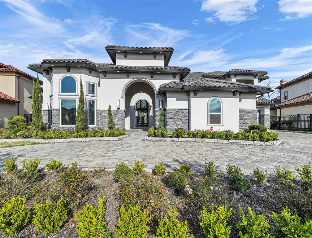 WOW!! RARE OPPORTUNITY to purchase recently built 7,000+ square foot home W/NO BACK NEIGHBORS in the EXCLUSIVE GATED Section of The Enclave at Riverstone. This AMAZING home w/2BR down w/2nd large enough to be a 2nd Primary has a lot of WOW factor starting w/the elegant brick & stone elevation out front. The interior courtyard leads to a grand entry w/double staircase, high ceilings & a wall of windows. Dramatic living spaces through out the home will impress all of your guests. The gourmet kitchen w/large island leads to your family room & first floor gameroom which is fantastic for entertaining large groups. Luxurious primary suite w/spa like bathroom leads into your dream TWO STORY MASTER CLOSET.   Separate bar/wine room ready for your finishing touches.  Covered patio and balcony. Step outside and enjoy your HUGE backyard with privacy and plenty of space to put in your pool, playground or whatever else you can envision.   Prime location close to area shopping/dining...DON'T MISS IT!
