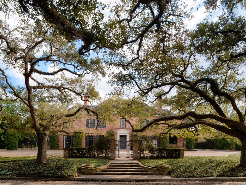 Positioned under a canopy of trees along the renowned Broadacres boulevard, this historic John F. Staub design is individualized as his reinterpretation of a classical French manorial estate. With renovations by Michael Landrum that complement the home's historic nature, the floor plan pivots around the 2-story polygonal entrance hall, dedicating space for elegant formals, a chef's kitchen, study, sun room, game room, 4 bedrooms, & 4.2 baths rife with antique design elements sourced from Europe. Lofty ceiling heights & floor-to-ceiling triple-hung windows imbue the main arteries with a degree of grandeur & voluminous natural light, making the interior feel connected with the outdoors. French doors invite you outside to explore the near-acre grounds, complete with a covered patio, summer kitchen, pagoda, heated saltwater pool spa, & extensive green space. Additional features include a gated driveway, basement, 3rd floor flex space, & guest quarters with full kitchen+bath