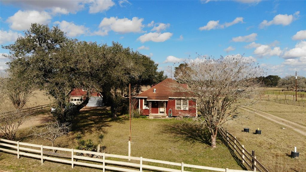 """Take advantage of this rare opportunity to purchase 47.75 acres in Lavaca County just minutes from the historic town of Yoakum, TX. This secluded homestead consists of a great mix of wooded acres, beautiful mature trees and open pastures. Take advantage of having two ponds for catching those delicious catfish! Continue enjoying the country life in this quaint 1300 square foot farmhouse that has 3 bedrooms and 1.5 baths. House needs a bit of TLC, so renovate and make it your own. Property also has a """"red barn"""" detached garage, a newer metal barn to house tractors and tools, hay sheds for feed, and cattle pens. This property would make a great single family home or a great vacation get-a-way! An ag-exemption is in place through livestock grazing keeping taxes to a minimum. Don't pass this up! See aerial video attached."""