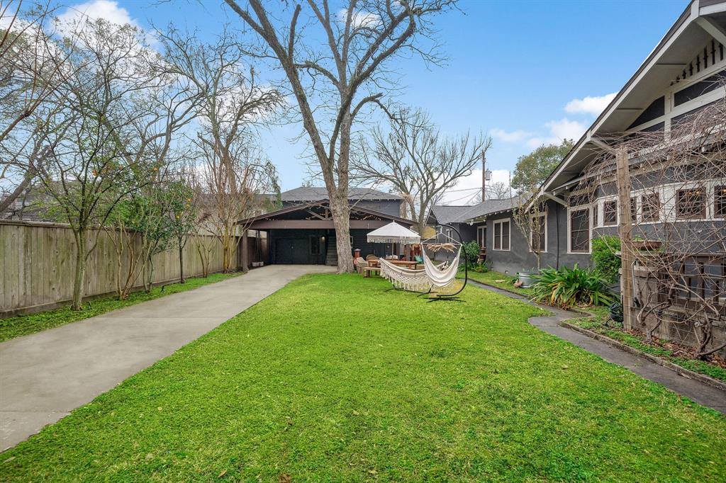 Expansive gated yard with lots of green space, perfect for parties and celebrations.