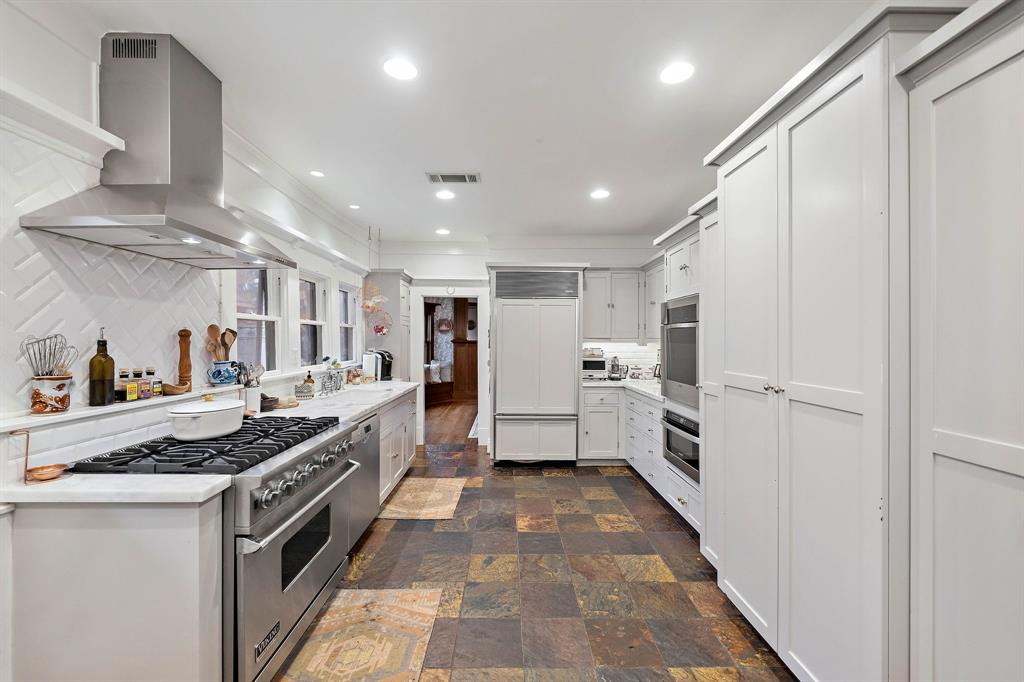 Custom kitchen with Viking and Sub Zero appliances as well as Carrara marble countertops.