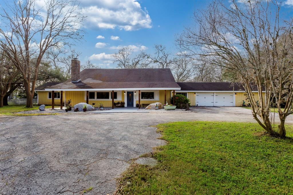 Luxurious Farmhouse on over 3 acres updated with porcelain tile floors through out first floor. Large Primary bedroom w/ attached office nook. Updated Primary bathroom with storage galore!  Primary closet 15' x 12' is a storage dream come true with barn doors. Additional fullbath on first floor with antique clawfoot tub.Bonus room w/ 1/2 bath on first floor. Large scattered trees through out the entire property.  Huge Gazebo in the backyard w/concrete slab is an incredible location for outdoor gatherings. Complete w/ electricity and chandelier for country chic. Located on the property you will find stables w/ 3 stalls, chicken coop as well as a structure for storage. These structures are being included w/ no value to listing price. This incredible farmhouse property is beaming w/character and custom details. Sq. footage is larger than appraisal information with bonus room and 1/2 bath.