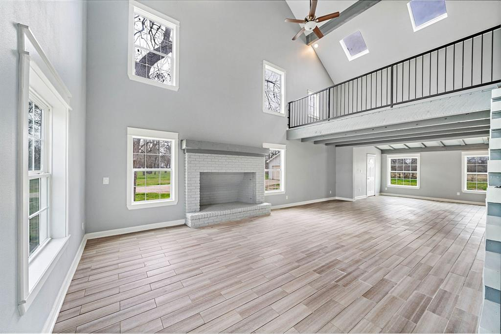 Click for 3D Tour! ABSOLUTELY STUNNING IS THE ONLY WAY TO DESCRIBE IT!! Welcome home to 1635 Pony Lane on 1.7 acres w/ mature trees, backing to a large ranch in Simonton, TX & zoned to Lamar ISD! This BEAUTIFULLY REMODELED 3 story boasts 4 large bedrooms, a 3rd floor bonus rm/5th bedroom, 3 full bathrooms (2 en suite), formal dining room and a 2nd floor loft. The super spacious kitchen features shaker-style cabinets, GRANITE countertops, stainless steel appliances & a massive island w/ lots of extra storage. Gorgeous wood-look tile flows perfectly throughout the living & dining areas. Unwind after a long day in the large master suite. The roomy master en-suite features a walk-in shower, soaking tub, separate sinks, built-ins and a vanity area. Don't forget to check out the 2nd floor's 3 large bedrooms (1 w/ full en-suite bathroom) and loft area that could be used as a game room or study. New roof, windows, siding, plumbing, electrical & 1 HVAC! Other HVAC 4 yrs old. Low HOA! Low taxes!