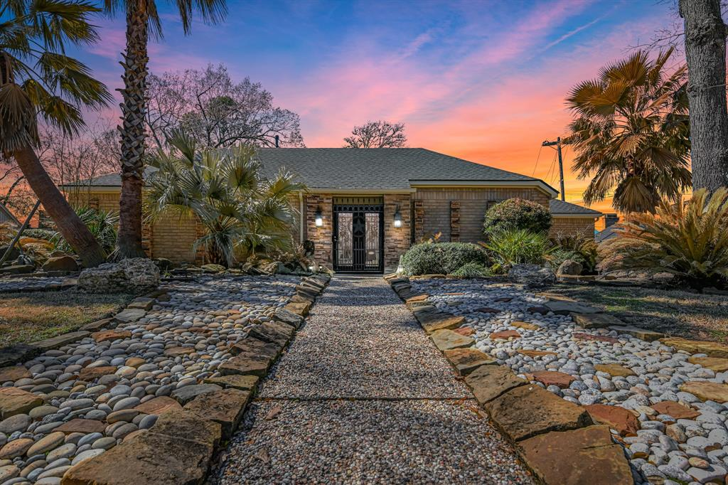 Location is everything! This beautiful 1 story is located minutes from the energy corridor & downtown. It's perfect location off BW8 gets you to I-10 within 5 minutes heading in either direction. Fully updated inside & out. Stainless steel appliances complete this unique kitchen renovation which includes an extra large breakfast island for extensive counterspace & added storage. Beautiful rustic tile floors make this open concept floorplan even more appealing. You will be entranced with the exquisite chandelier in the family room. One of a kind built-ins throughout. Relax and enjoy quiet evenings thanks to the triple pane windows and shutter blinds that tune out the outside world. New roof installed in 2017. This oversize lot is perfect for entertaining. Located in a family friendly subdivision. The incredible oaks & pine trees throughout the neighborhood give it a park-like feeling. This home has never flooded.